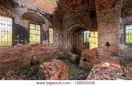 The brick ruins of the interior of an abandoned temple. Dilapidated vault