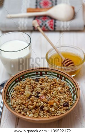 A healthy breakfast: Mosley with candied fruit, milk and honey