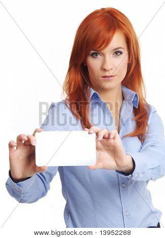 Beautiful redhead woman with notecard.