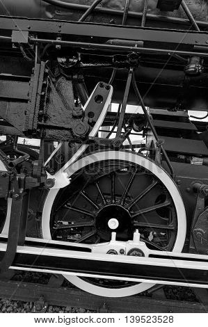 Old german steam locomotive built in 1940. The heaviest locomotive 85 tons that circulated in Romania during the Second World War. Detail and close up of huge wheels. B & W processing.