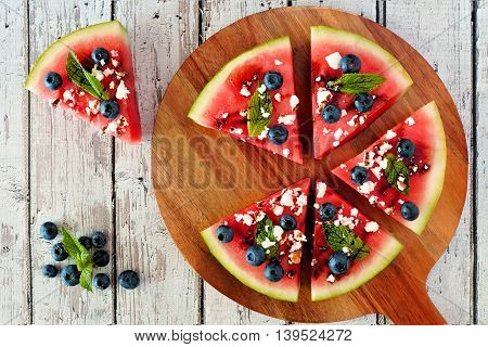 Sliced, Juicy Watermelon Pizza With Blueberries, Feta Cheese, Mint And Balsamic Glaze, Overhead View