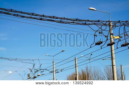 Trolley overhead line wire switch. Electrical cable. Electricity used in ecological transportation.