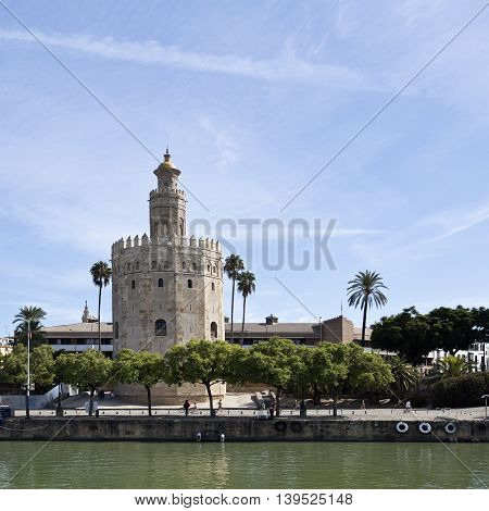 SEVILLE, SPAIN - September 13, 2015: The Torre del Oro (Tower of the Gold) a dodecagonal military watchtower seen from the Guadalquivir River on September 13, 2015 in Seville, Spain