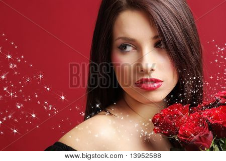 Beautiful woman with a magic rose over red background
