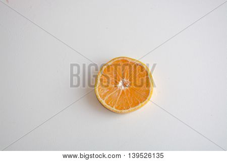 One Slice Of Tangelo Citrus Fruit On A Light Background