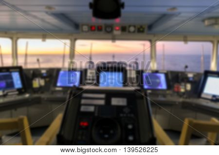 Blurred navigation bridge of merchant cargo ship.