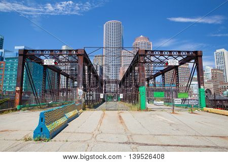 BOSTON,MASSACHUSETTS,USA - JULY 15,2016: Boston skyline and Northern Avenue Bridge. Built in 1908 it was closed to vehicle traffic in 1999