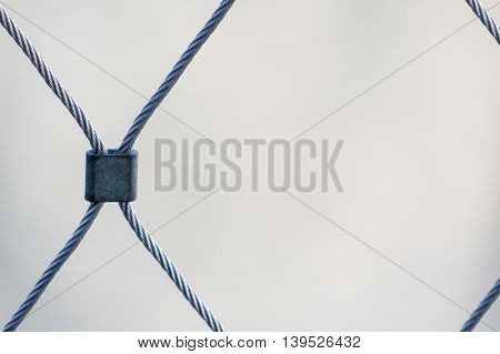 Diamond pattern created by steel clip on wire cable fence
