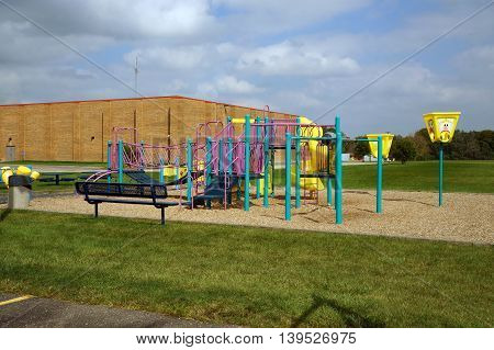 SHOREWOOD, ILLINOIS / UNITED STATES - AUGUST 30, 2015: Children may play in a playground behind an elementary school in Shorewood.