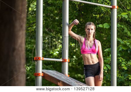 Young Sportswoman In Sportswear On Outdoor Nature Sports Ground