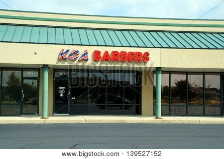 SHOREWOOD, ILLINOIS / UNITED STATES - AUGUST 30, 2015: One may have one's hair cut at KCA Barbers, in a Shorewood strip mall.