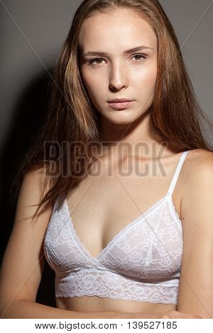 Young Attractive Woman In White Lace Bra