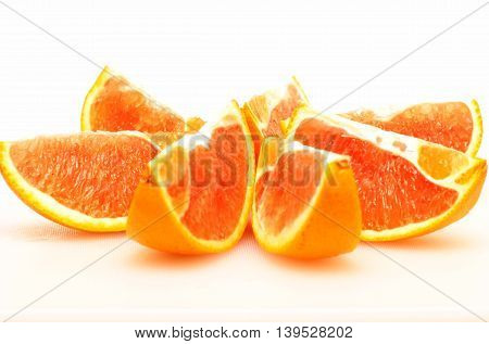 Orange cut in slices for food industry concept