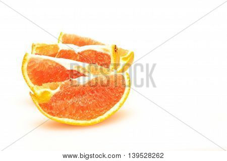 Delicious looking orange cut in slices, ready to eat.