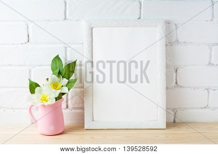 White frame mockup with rustic pink flower pot. Portrait or poster white frame mockup. Empty white frame mockup for presentation artwork design.