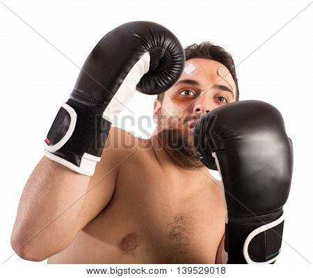 Frightened man boxer with plasters and bruises