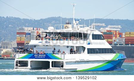 Oakland CA - July 18 2016: The San Francisco Bay Ferry provides passenger service from Oakland and Alameda to the Ferry Building Pier 41 Angel Island and Oyster Point in San Francisco.