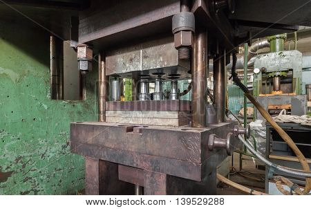Old hydraulic press close-up on machinery plant