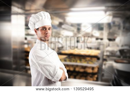 Chef with hat and apron in a kitchen of a restaurant