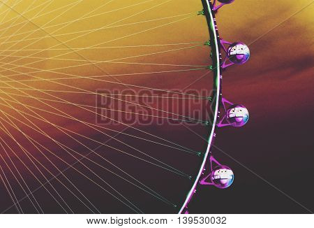 purple ferris wheel with cloudy sunset sky by inverted the color