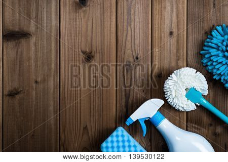 Flat layout cleaning tools placed on the wood table