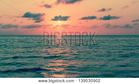 Beautiful sunset with red reflections over a calm Sea.