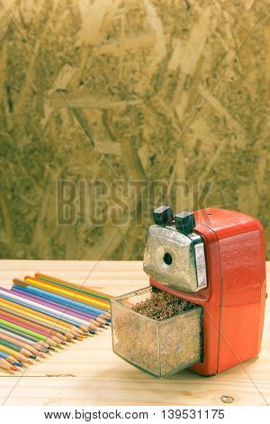 Stationery on wooden background Vintage tone .