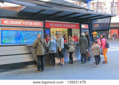 MELBOURNE AUSTRALIA - JULY 16, 2016: People inquire at Tourist Information Centre on Burke St Melbourne. Melbourne is a major tourist destination in Australia offers variety of attractions and events