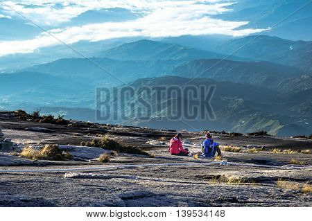 Mount Kinabalu,Ranau,Sabah-March 13.2016:Group of climbers enjoying the view of the Ranau and Kundasang town from Mountain Kinabalu in the morning.
