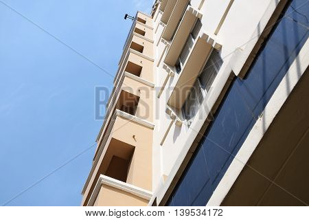 Look up at apartment housing in Thailand. the Step of building.