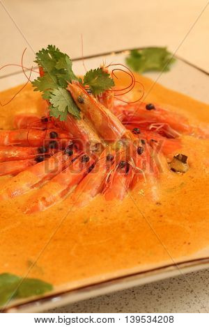 Shrimp soup with curry on plate in restaurant