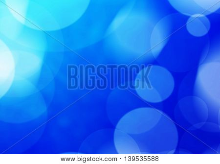 Blue abstract light effect background holiday card.
