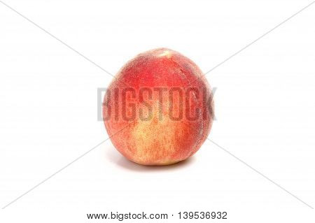 One peach isolated on a white background