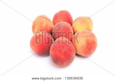 Seven peaches isolated on a white background