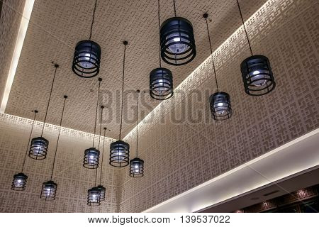close up hanging black ceiling lamp decoration luxury style