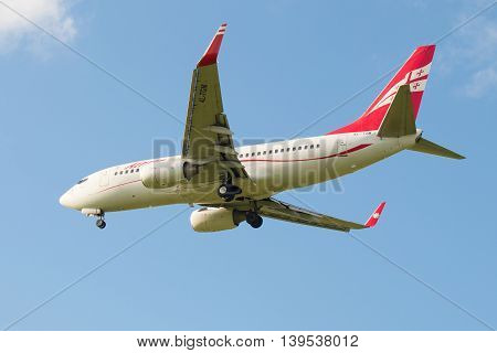 SAINT PETERSBURG, RUSSIA - JULY 24, 2015: The Boeing 737-700 (4L-TGM) of the company Georgian Airways before landing in Pulkovo airport