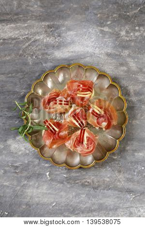 traditional Italian appetizer parma ham with melon - prosciutto melone