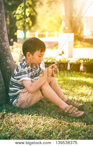Happy Asian Boy With Camera Relaxing Outdoors In The Day Time, Travel On Vacation.