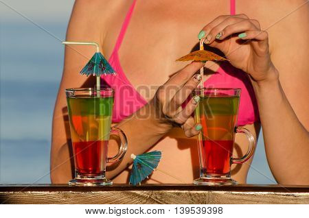 Girl on the beach cocktail decorated with the sea in the background