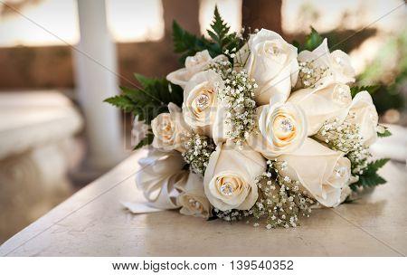 White wedding bouquet of roses in sepia tones