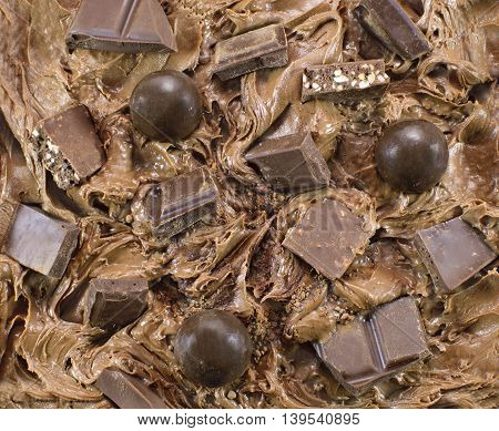 Chocolate cream background with candies and nuts