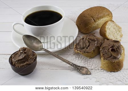 Coffee with chocolate cream on slices of fresh bread