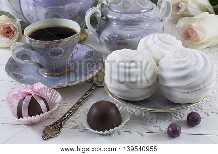 Coffee with marshmallows and chocolate candies, sweet background