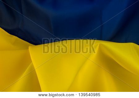 Background Flag of Ukraine. Yellow symbolizes the wheat fields under blue sky in Ukraine. Ukrainian flag symbolizes the eternal desire of the people for peace labor beauty and richness of their native land.