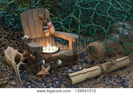 Still life with bottle, candle and paper roll, nautical romantic concept