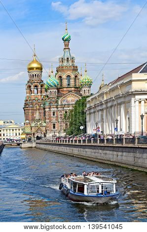 Saint Petersburg Russia - Aug 25 2015: Touristic boat near Church of the Saviour on Spilled Blood (Spas na Krovi) St. Petersburg Russia