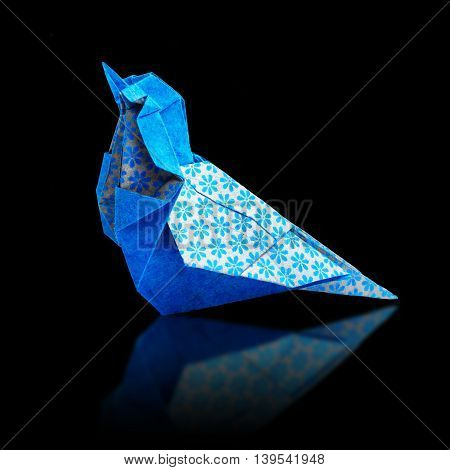 Origami art blue and bronze metalic floral bohemia pattern paper bird on a black background