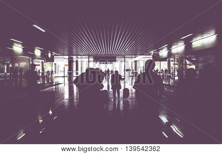 Vintage Filter : Silhouette Of Passenger Walking Through Train Gate With Light At The End Of Gate