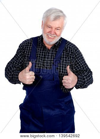 Portrait of smiling senior craftsman with both thumbs up