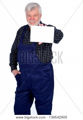 Smiling senior craftsmen showing white sign isolated on white background